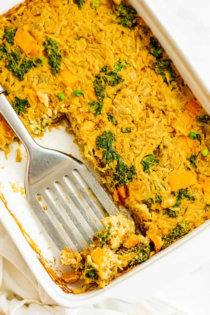 Vegan hash browns casserole after a serving has been removed.
