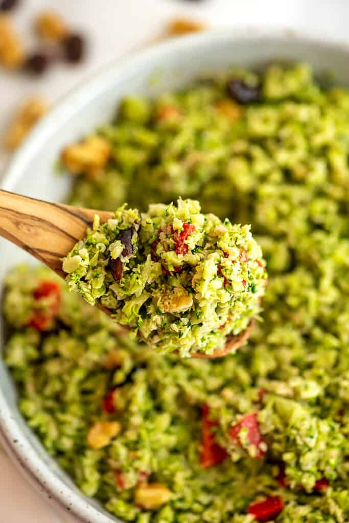 Large spoonful of riced broccoli salad.
