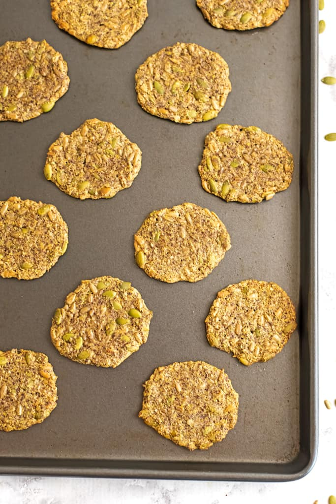 Seed crackers on a baking sheet after baking.