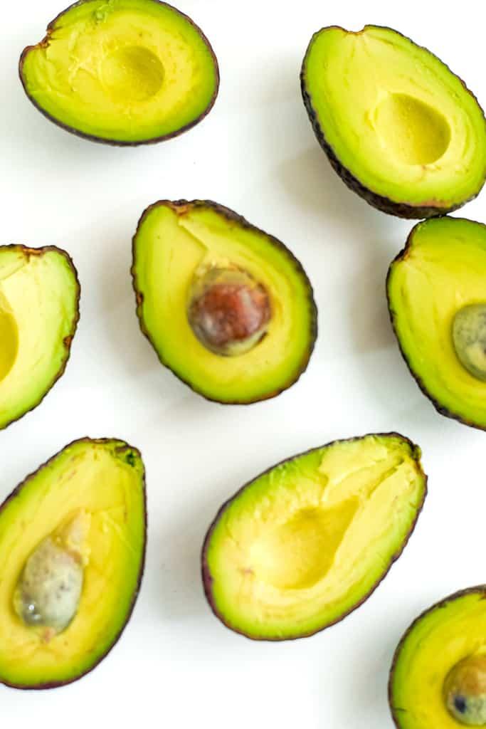 Ripe avocados cut in half.