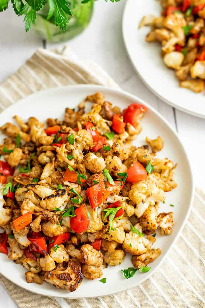 Balsamic roasted cauliflower and peppers on a plate.