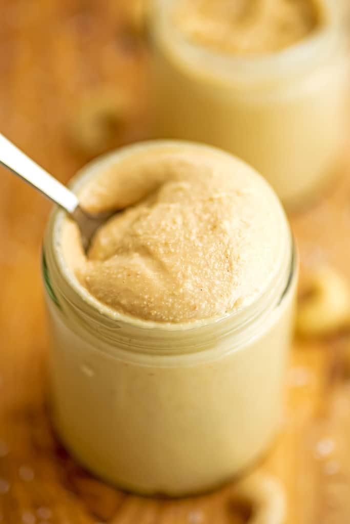 Spoon in a jar of cashew coconut butter.