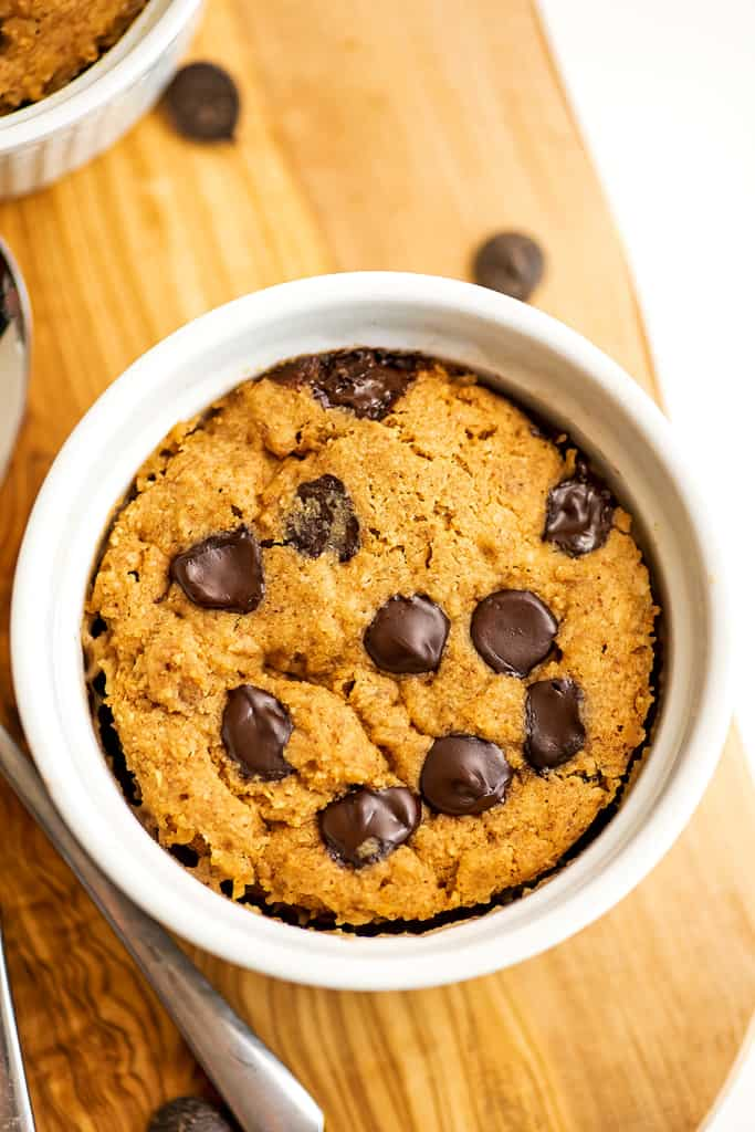 Vegan protein mug cake with chocolate chips on top.