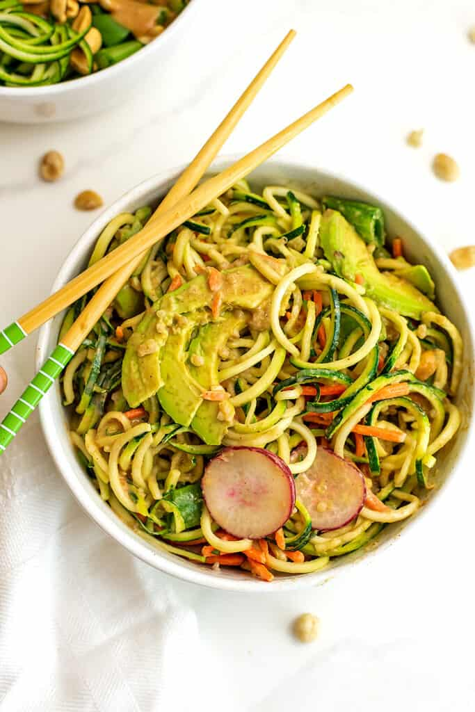 Asian zoodle bowl after stirring in the peanut dressing.
