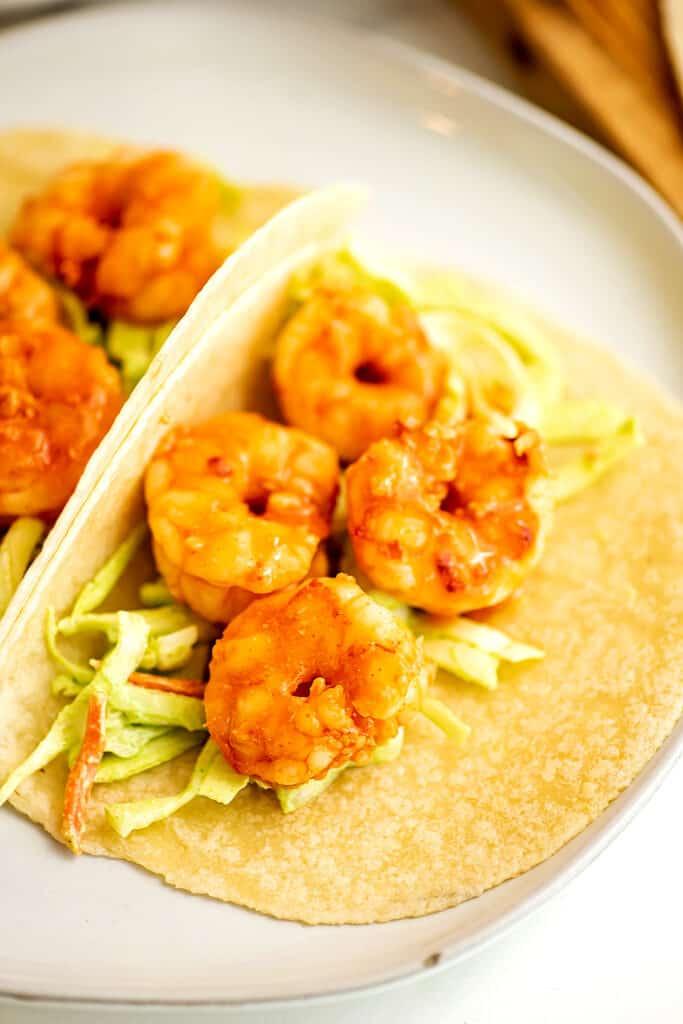 Grilled buffalo shrimp tacos with cilantro lime slaw.