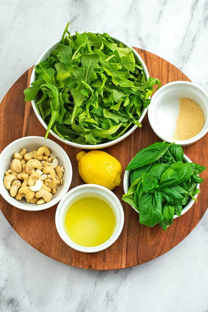 Ingredients to make arugula pesto.