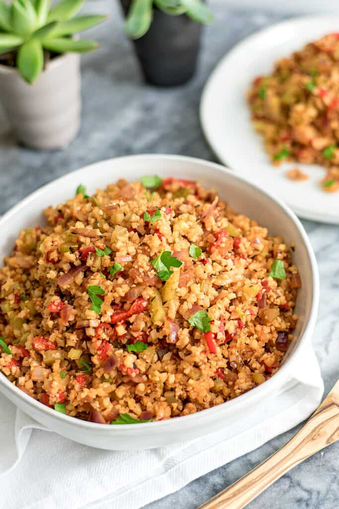 Large bowl filled with dirty cauliflower rice.