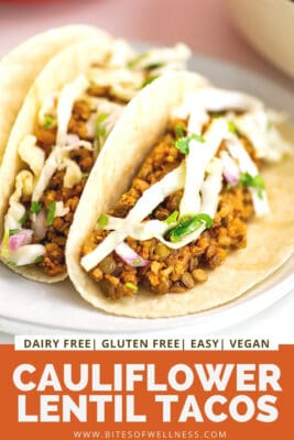 Cauliflower lentil tacos on a plate with slaw on top.