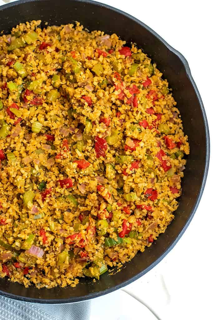 Cauliflower dirty rice in a cast iron skillet.