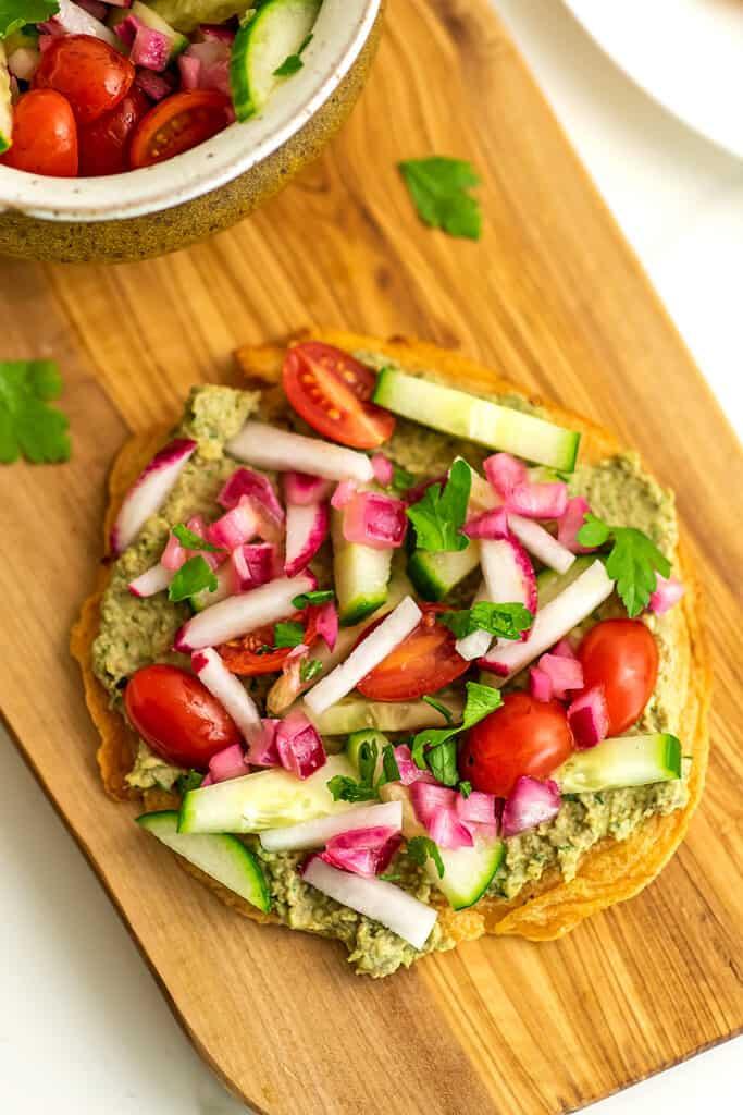 Hummus and veggies on a lentil flatbread.