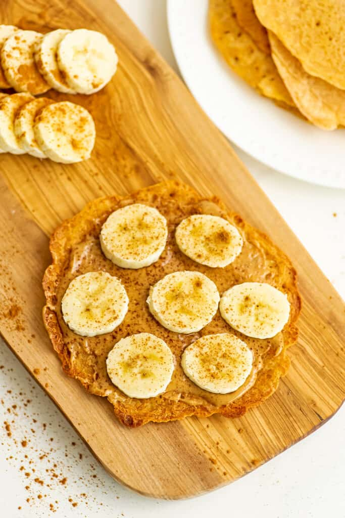 Peanut butter and sliced banana on a lentil flatbread.