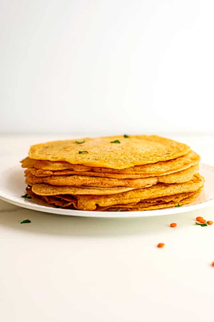 Lentil flatbreads stacked on top of eachother.