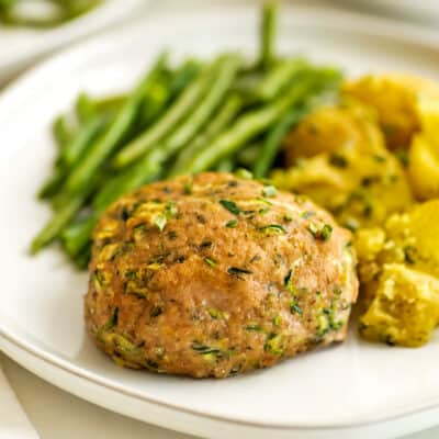 Ranch turkey meatloaf on a white plate with green beans.