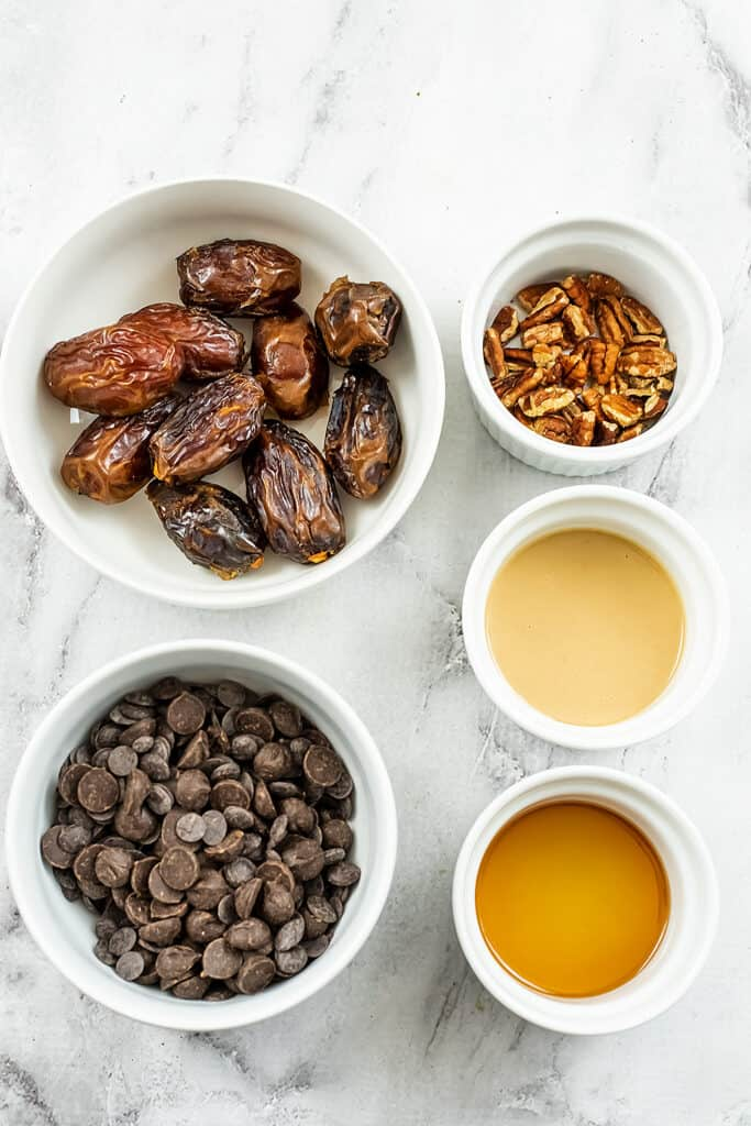 Ingredients to make chocolate covered stuffed dates.