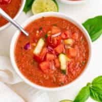 Spoon in a bowl of watermelon gazpacho.