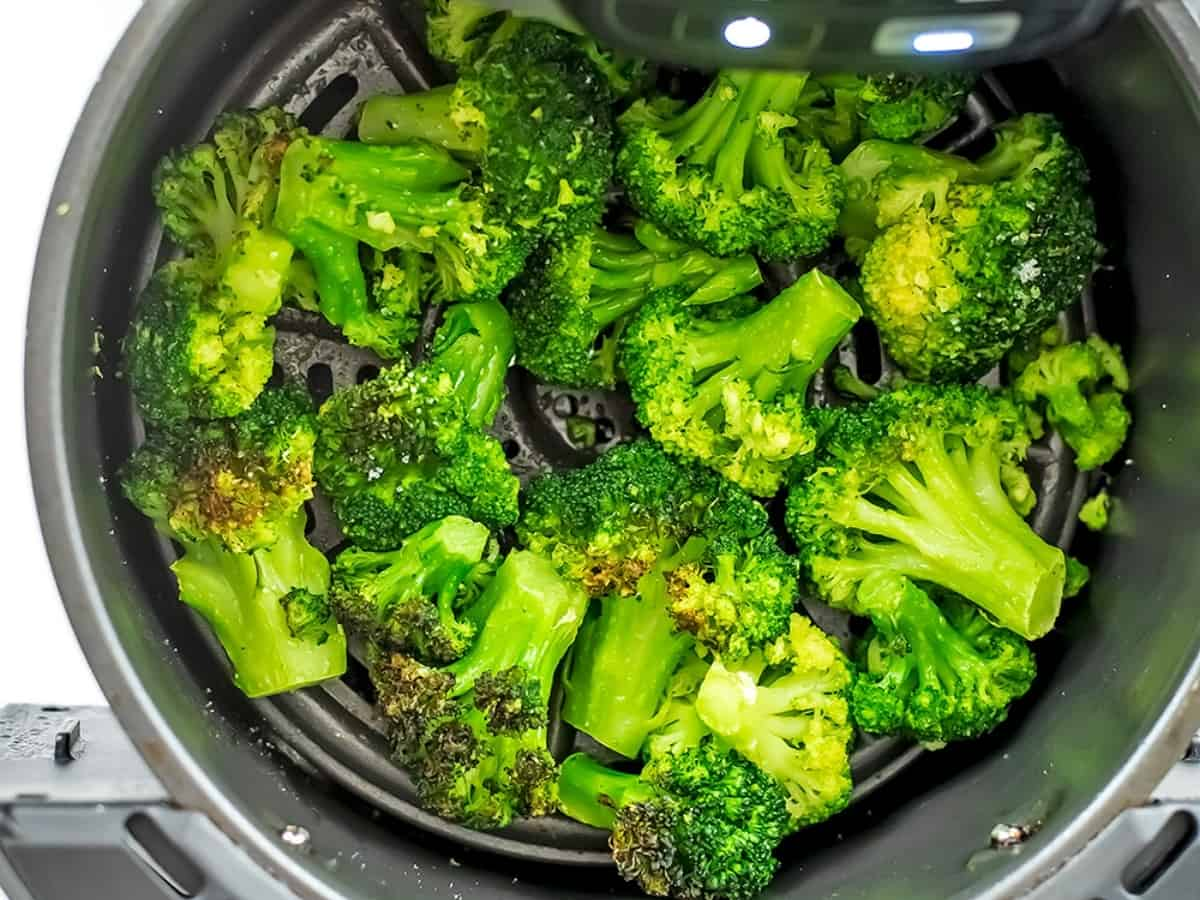 Frozen broccoli after 10 minutes of cooking in air fryer.