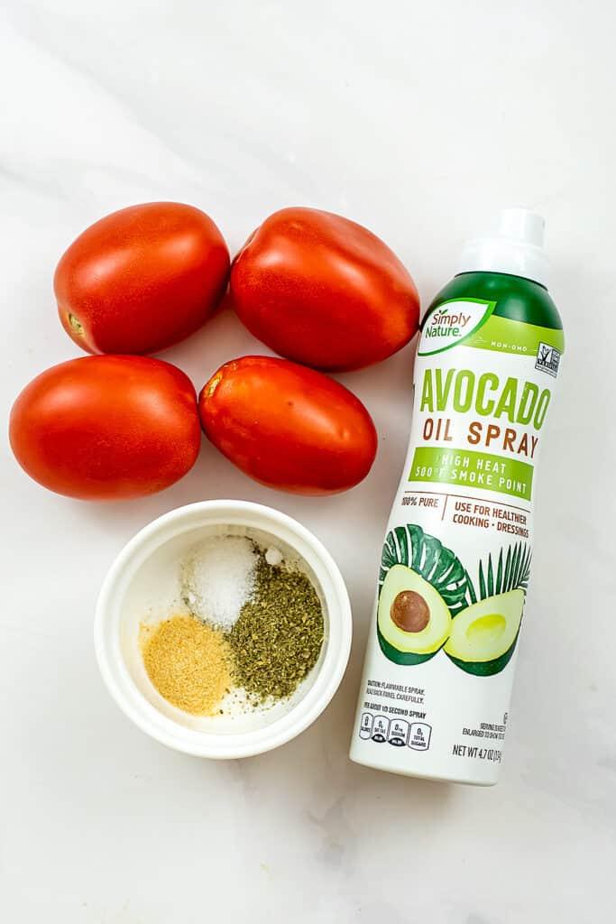 Ingredients to make air fryer tomatoes.