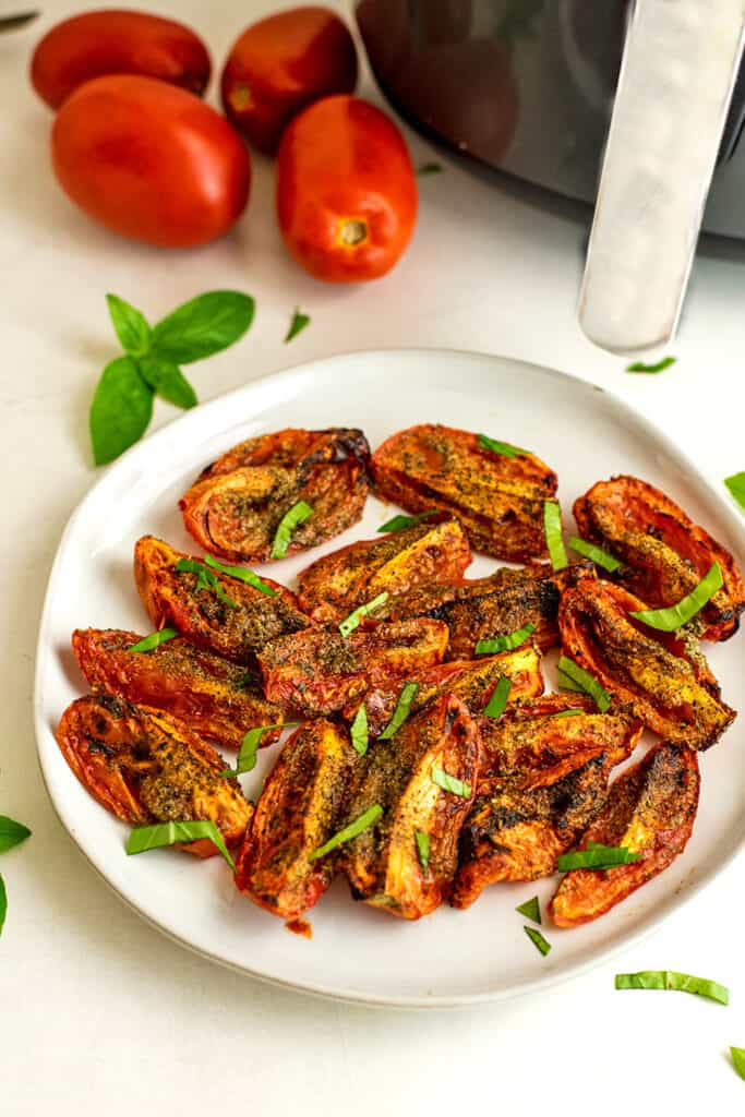 Air fryer tomatoes on a white plate.