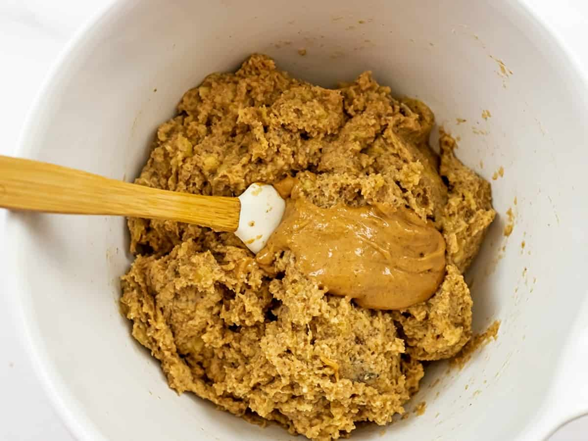 Peanut butter being added to the almond flour banana batter.