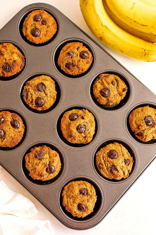 Banana almond flour muffins in a muffin tin.