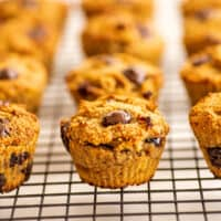 Almond flour banana muffins lined up on a cooling rack.