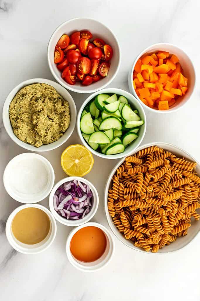 Ingredients to make hummus pasta salad.