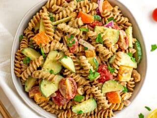 Bowl filled with vegan hummus pasta salad.
