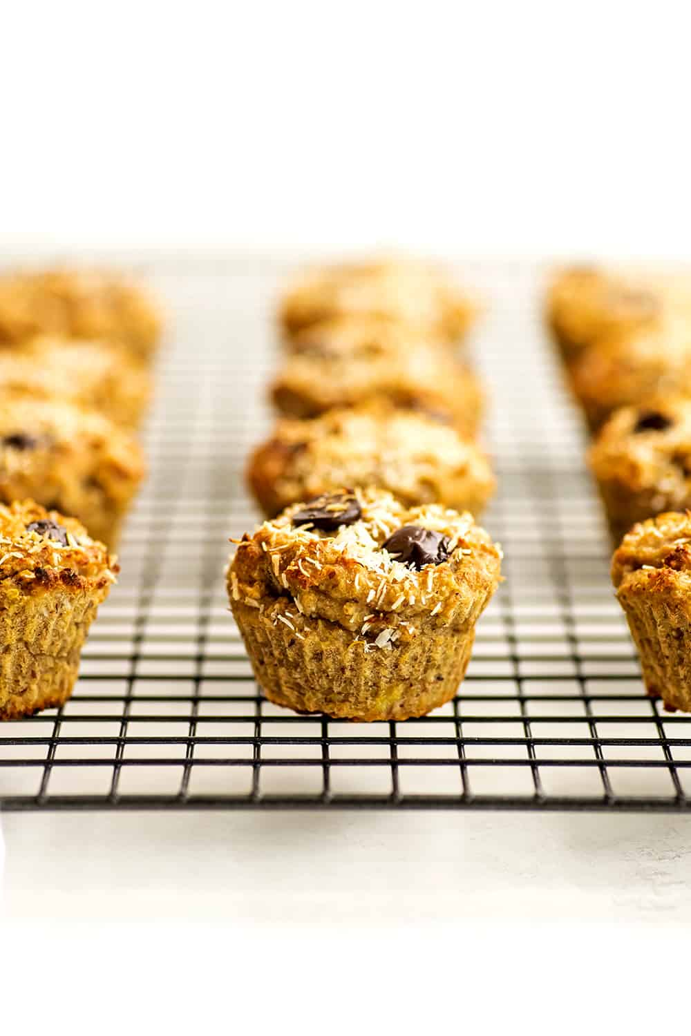 Quinoa banana muffins cooling on a wire cooling rack.