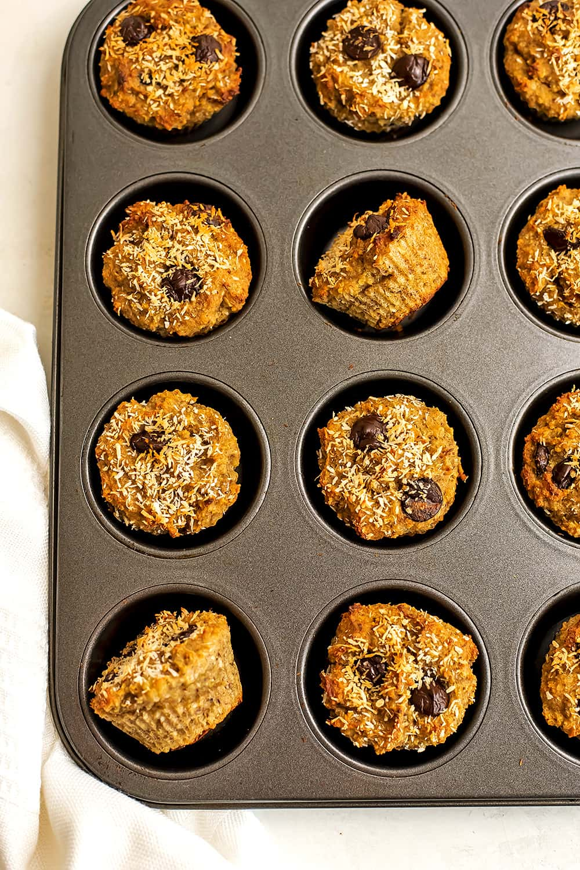 Quinoa banana muffins in a muffin tin after baking.