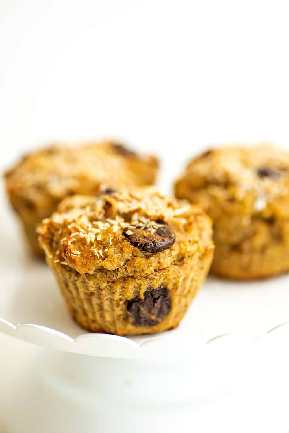Quinoa banana muffins on a white serving tray.