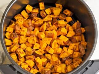 Air fryer sweet potato cubes after cooking.