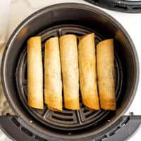 Vegan taquitos in air fryer after cooking.