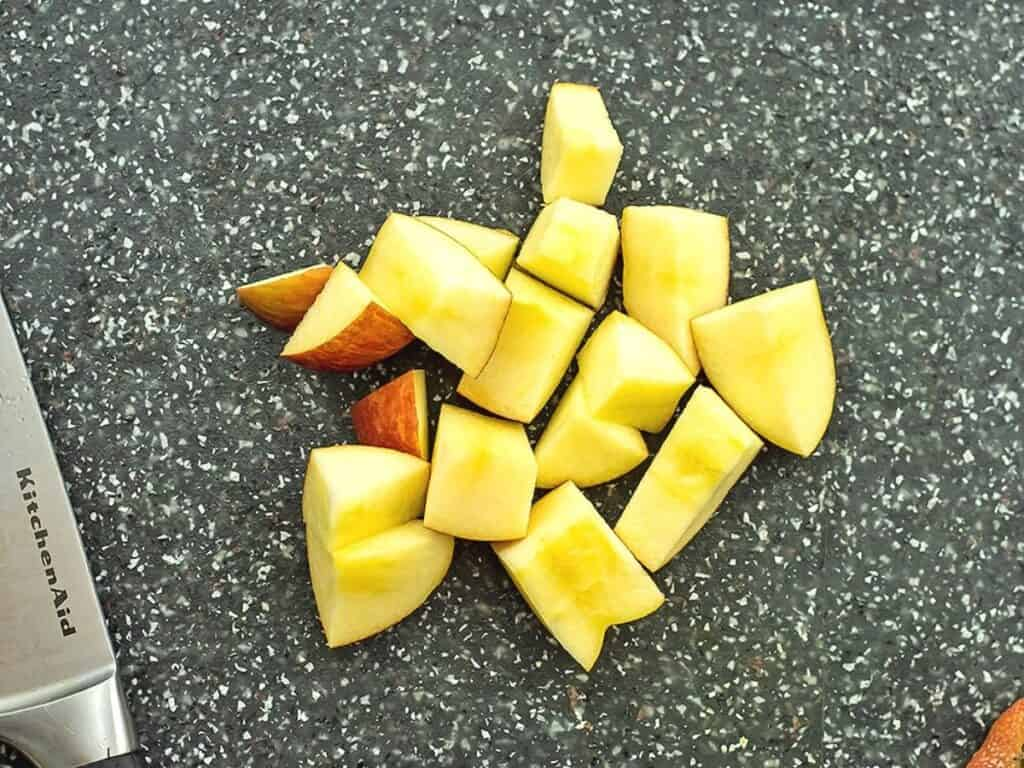 Apple cut into cubes for smoothie.