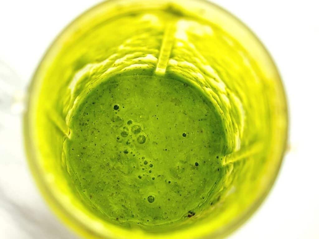 Banana spinach apple smoothie after blending.