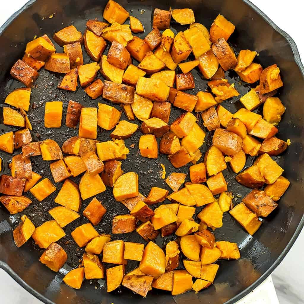 Sweet potatoes in skillet after cooking in oil for 3 minutes.