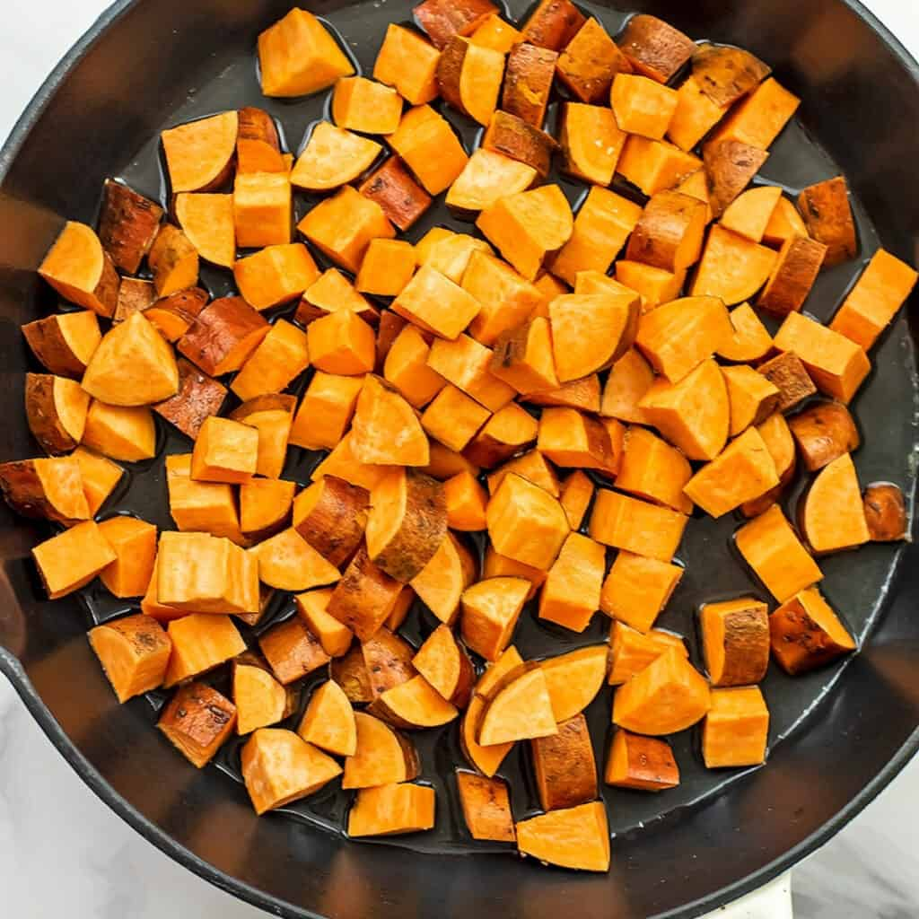 Sweet potatoes in skillet raw before cooking.