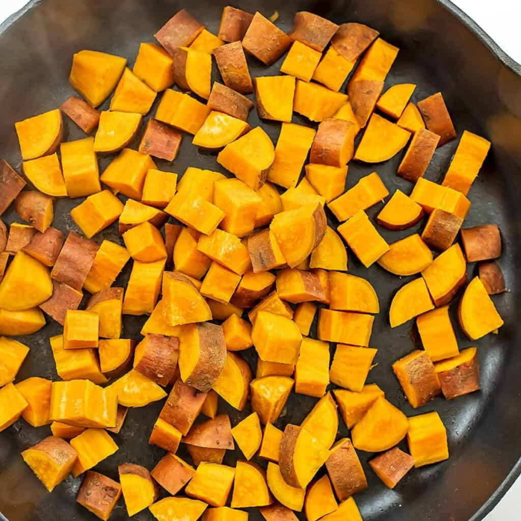 Sweet potatoes in skillet after steaming for 7 minutes.