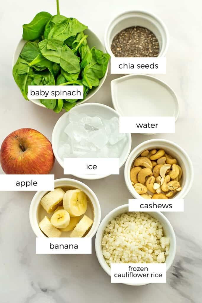 Ingredients to make spinach apple banana smoothie.