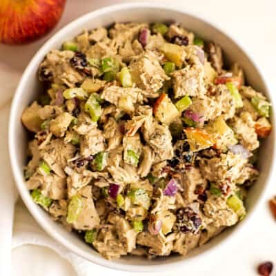 Large bowl filled with cranberry pecan chicken salad.