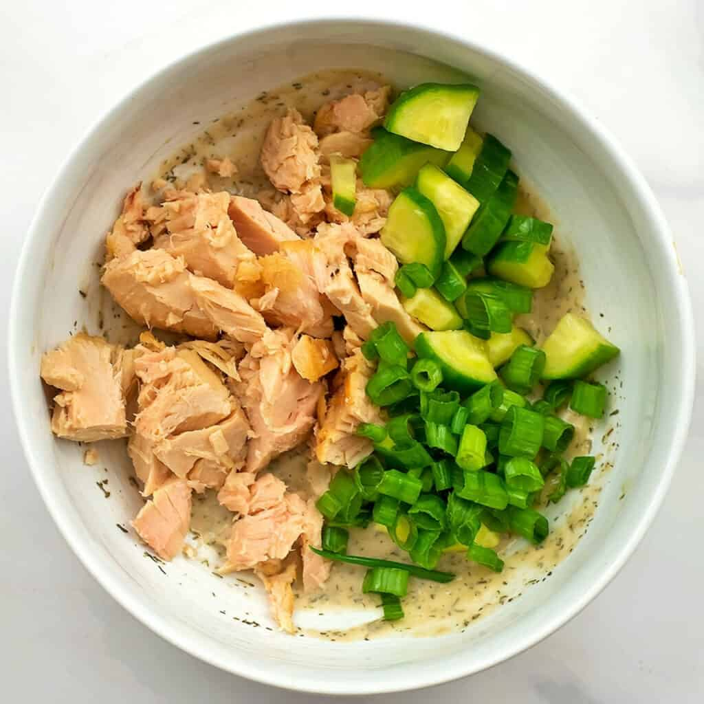 Tuna and veggies in the bowl with the dressing.