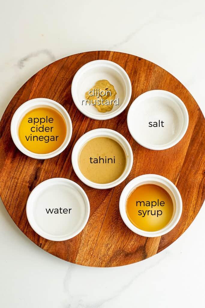 Ingredients to make maple tahini dressing.
